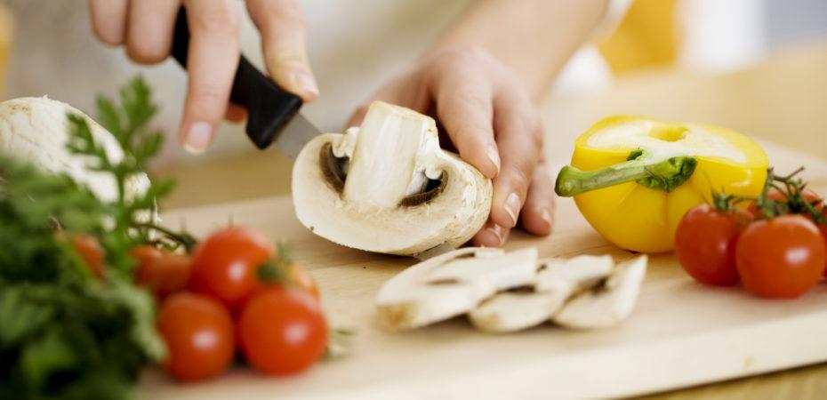 female chopping food ingredients